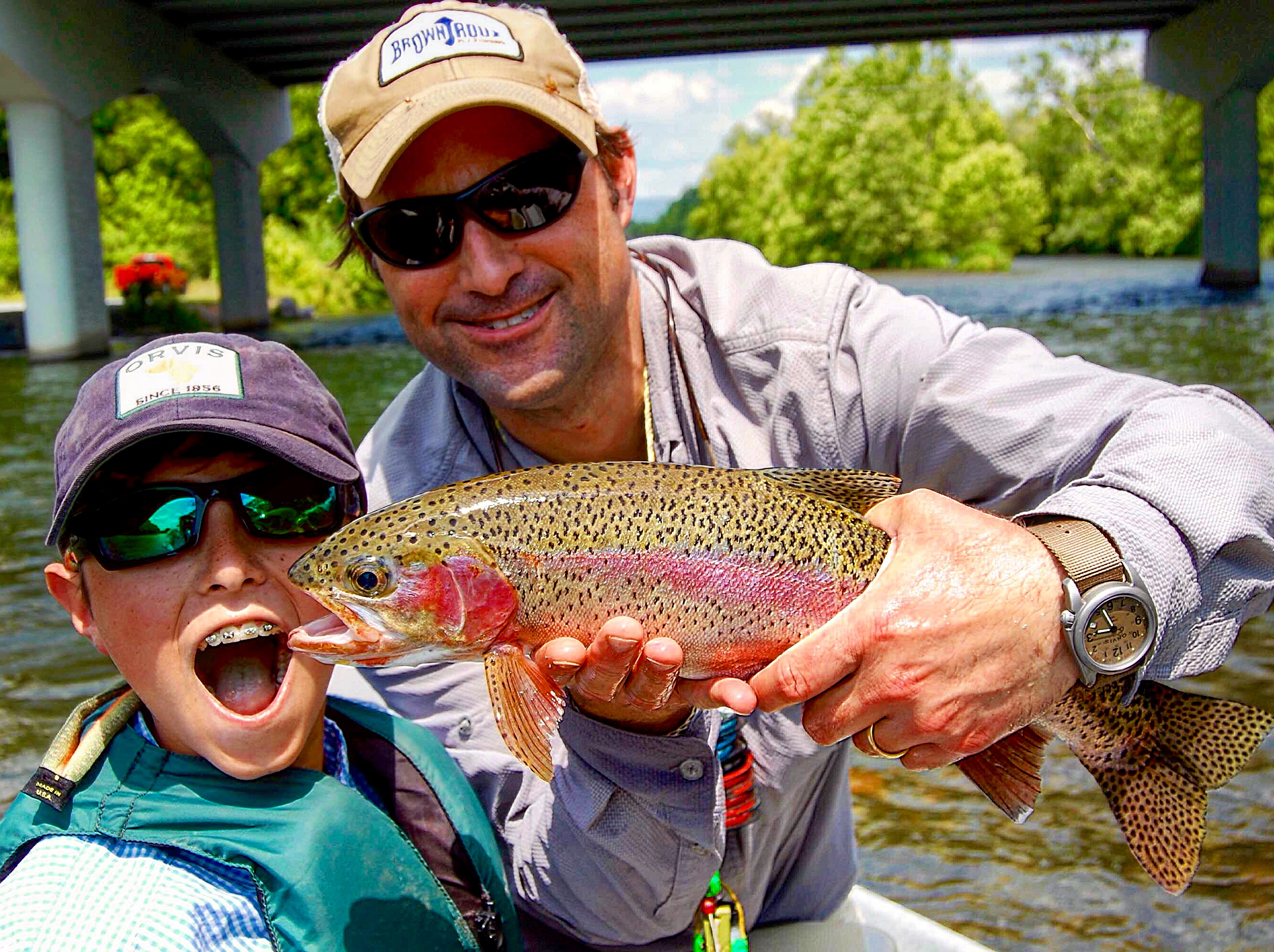 ORVIS Greenville's Fishing Manager Mark White displays a great Rainbow Trout from the Watauga River